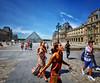 Exploring Paris at the Louvre (` Toshio ') Tags: toshio paris france tourists people woman girl man pyramid louvre museedulouvre louvremuseum french europe european europeanunion palace fujixe2 xe2