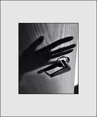 Closing the door, and making an image (Bob R.L. Evans) Tags: door doorhandle shadow ipadphotography unusual mystery