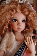 The Mandolin Player (Emily1957) Tags: dolls doll toys toy music musician mandolin toymandolin felicitysguitar light naturallight availablelight nikon nikond40 kitlens kayewiggs resin closeup