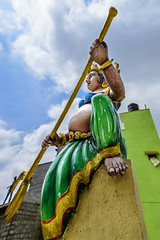 Kavalamma - The Lady Guard with a Trident at a Temple in Bengaluru, India (Anoop Negi) Tags: kavalamma india karnataka south tamil kannada door keeper guard female dwarapala bangalore bengaluru religion hindu hinduism against sky tyrident man green building anoop negi ezee123 photo photography outdoor color pop kitsch fertility symbols large tummy sculpture iconography