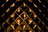 Golden symmetrie (Nederland in foto's) Tags: nederlandinfotos nederland netherlands nikon paulvandevelde pdvandevelde padagudaloma creative abstract symmetrie glas crystal patern lines texture pattern blackbackground