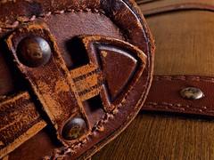 Leather peeling (•Nicolas•) Tags: macro nicolasthomas detail camerabag collection collectible zeiss ikon superikonta leather cuir peeling rivet arrow flèche sac étui macromondays itsapeelingtome lighting lumière shadow ombre