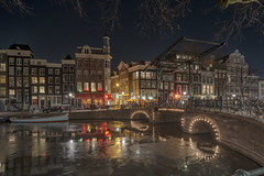Amsterdam night (angheloflores) Tags: amsterdam canal houses clouds sky colors bridge lightsz travel architecture urban explore water reflections netherlands