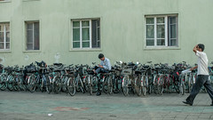 Man studying while sitting on bicycles (fvfavo) Tags: bicycles studying kp northkorea dprk nordkorea kangwon