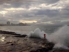 Malecón (Marc Gascoigne) Tags: ocean street city sea urban man outdoors person grey evening havana cuba streetphotography wave running run breakingwave malecón iphone lahabana mobilephonephotography iphonography