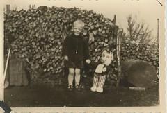 boy rubble and a toy animal- Germany, 1955 (912greens) Tags: boys germany children toys favorites stuffedanimals vintagetoys folksidontknow