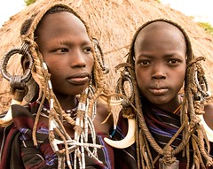 Mursi Girls (Rod Waddington) Tags: africa african afrika afrique äthiopien ethiopia ethiopian ethnic etiopia ethnicity ethiopie etiopian omo omovalley mago girls two mursi tribe traditional tribal portrait people decoration costume horns beads hut