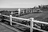 """Entering The Marginal Way Walk  - Ogunquit, Maine, 2016 (Photographie Alexi """"Alvin"""" Dagher Photography) Tags: ©alexidagher 2016 architecture atlantic bandw bw barrier beaches beautiful blackwhite blackandwhite bluesea bluesky bnw buildingcomplex calm coastline day facades fence field grass horizontal human landscape lookingahead mainefineart mainegifts maineimage mainelandscapestockimage mainelove mainephoto maineprints maineseascapes mainesummer mainetourism marginal monochrome new ocean ogunquit old ominous one open outdoors person photoofmaine port printsofmainescenery relaxing road rockformation rocks scenery scenic seascapeofmaine seaside shore sky standing streetphotography sunny tourism townhouse travel trees usa vacationland village water waves way wooden"""