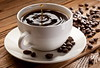 Drop falling into a cup of coffee (engvnnet) Tags: table background drop morning life brown wooden cup breakfast coffee bean caffeine dark espresso drink style splash saucer cafe still grain wood stilllife decorated robusta coffea canephora