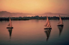 Sunset on the River Nile (Christina's World aka Chrissie Bee) Tags: boats sailboats falukas egypt nile river water scenic textures sunset painterly
