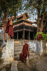 Three little monks at Shwe In Bin Monastery, Mandalay, Myanmar (syukaery) Tags: trip travel people boys religious burma buddhist sony sigma buddhism landmark monastery monks myanmar burmese mandalay humaninterest 19mm mirrorless a6000