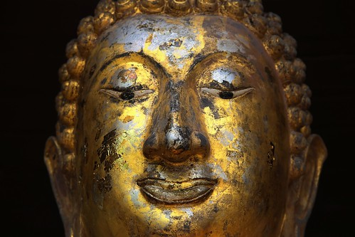 Buddha statue decorated with thin golden plates