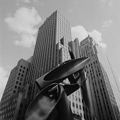 Art & Architecture (UberJ) Tags: city blackandwhite bw sculpture white black 120 6x6 film oklahoma statue zeiss buildings square outside downtown hasselblad f plus pan 500 okc ilford distagon 500cm panfplus firstnationalcenter leadershipsquare distagon50mmf4