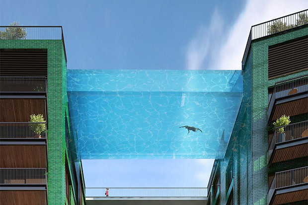this-glass-bottomed-swimming-pool-bridges-two-buildings-2