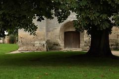 Entre de la tour Saint-Nicolas, de style anglo-normand, de l'abbaye catholique bndictine Notre-Dame du Bec, Le Bec-Hellouin, Eure, Haute-Normandie (Laurent Gan) Tags: france 1948 monument architecture construction tour pierre culture architectural notredame histoire porte normandie bec 27 chevalier difice campagne arbre pape comte moines bois monastre pelouse eure tronc incendie patrimoine 1810 abbaye clocher saintnicolas historique 1073 religieux xie 1050 1039 xvi abbatiale sicle lebechellouin btiments marronnier xviii catholique communaut xvii 1060 1467 hautenormandie 1034 cloches 27800 bechellouin xviiie btisse notredamedubec xviie alexandreii anglonormand rgence herluin laurentgan geoffroydepaignes jehanboucart gilbertdebrionne lanfrancdepavie anselmedecantorbry paulemmanuelclnet