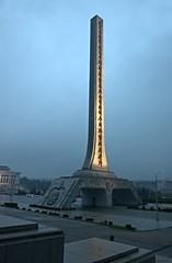 Grand mandatory stele (Frhtau) Tags: street city light people night asian evening asia propaganda political capital hauptstadt north illumination scene korea east korean stadt obelisk stele leader motivation slogan sentence ideology pyongyang dprk  juche mandatory nordkorea   choxin