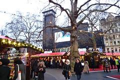 P1090855 (smith.rodney74) Tags: stalls lights highvizjacket redcarpet woolyhat barebranches onmyphone stringoflights