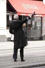 Hotel doorman hailing a cab (Ian Press Photography) Tags: hotel doorman hailing cab hail taxi strand london