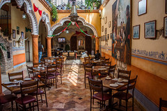 2016 - Mexico - San Sebastián Bernal - Lunch (Ted's photos - For Me & You) Tags: 2016 bernal cropped mexico nikon nikond750 nikonfx queretaro tedmcgrath tedsphotos tedsphotosmexico vignetting hotelescentenario hotelescentenariobernal bernalqueretaro restaurant seating seats arches tables tablesetting chairs cafe pueblomágico magictownsofmexico columns