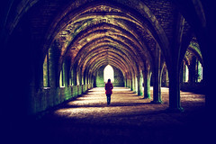 Towards the Light (iratebadger) Tags: nikon nikond7100 person perspective centralperspective central abbey ruins ruin hall stone building tamron1024mm tamron arches columns fountainsabbey nationaltrust iratebadger image d7100 distance woman