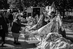 Feel the Quality (gwpics) Tags: street old people blackandwhite bw woman france monochrome lady female french person mono blackwhite women market streetphotography lifestyle elderly age older material aged cloth society normandy socialdocumentary socialcomment streetpics strasenfotograpfie