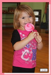 Girl and her sucker (PhotoJester40) Tags: indoors inside female littlegirl smiling happy candy sucker posing cutie 2yearold amdphotographer