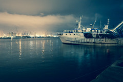 Clumby (France reOnAir) Tags: sea italy ferry night harbor boat industrial cloudy afterthestorm illuminated laspezia