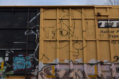 ? (TheGraffitiHunters) Tags: graffiti graff spray paint street art colorful freight train tracks benching benched face floater boxcar