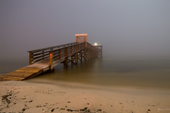 On a Moonlit and Foggy Night (rowe_rosemary) Tags: longexposure landscape nightphotography slowshutter fog moon fullmoon moonlight beach gulf mississippi travelmississippi quiet moody weather beachlife southern nikon d3200 rokinon 14mm still serene light darkness nightscape nightscene scenic view waveland pier bright water waterfront waterscape