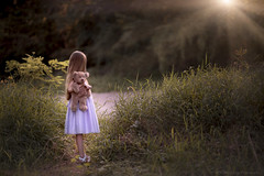 My sweet daughter, within you is the light of a thousand suns... (Syllhouette) Tags: christina benge photography christinabengephotography indiana light sun dawn dusk child children kid kids childhood youth young long hair teddy bear nature girl daughter fall forest path within thousand suns