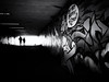 Through the underpass (Sandy...J) Tags: urban underpass tunnel grafitti noir darkness light blackwhite monochrom streetphotography silhouette walking