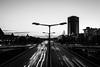 Lichtkreisel (S. Boblest) Tags: light autobahn lamp lampe laternen strasenlaterne steglitz berlin blackandwhite bnw bw schwarzweis sw schwarzweiss schärfentiefe stadt einfarbig monochrom monochrome evening cars autos verkehr symmetrie symmetrisch outdoor landstrase skyline architektur gebäude dämmerung gebäudestruktur infrastruktur
