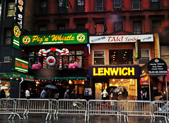 Restaurants on Rainy West 48th St. (Robert S. Photography) Tags: restaurants newyork rainyday scene people rain umbrellas manhattan street holidays seasonal decorations shops building fence signs city delis48 pigswhistle lenwich sushi pizza west48th nikon coolpic l340 iso360 latenovember 2016