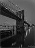 **SILENCE OF THE NIGHT** (**THAT KID RICH**) Tags: richzoeller zoeller thatkidrich tkr night nightphotography brooklynbridge manhattan bridge river arches iconic landmark landscape snow bw black white fineart water reflections pilons stone limestone newyorkcity ny nyc newyork