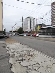 Sidewalk condition in Nashville. (Tim Kiser) Tags: 19thavenue 19thavenuesouth 2014 20140304 davidsoncounty davidsoncountytennessee img2991 march march2014 nashville nashvilletennessee nashvillestreetscape nashvilledavidson nashvilledavidsoncounty tennessee westend westendneighborhood asphalt asphaltconcrete asphaltconcretepaving asphaltpaving blacktop buildings centraltennessee constructioncranes crackedconcrete crackedpavement crackedpavment crackedsidewalk cranes crumblingpavement crumblingsidewalk doubleyellowline electriclines extendedcab extendedcabpickuptruck middletennessee overcast parkedcars parkedtruck parkinglots pavementcracks powerlines ruinedpavement ruinedsidewalk sidewalk sidewalkcracks street streetscape unitedstates