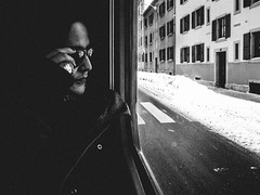 in dark sunglasses (matthias hämmerly) Tags: tavannes train glasses girl woman cold winter street candid streetphotography grain contrast switzerland jura black white ricoh grd snow windows window shades ring dark instide outside