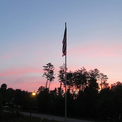 PINK SUNRISE..... (Daisy.Sue) Tags: sunrise earlymorning americanflag bluesky pinkclouds treesilhouettes stokesdalenc spring2015
