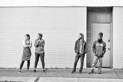 Audience (B&W) (exon) Tags: california street people canada men brick ice hat wall vancouver women phone cone britishcolumbia watching cream cell sidewalk sweatshirt