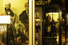 The line. (df-stop.) Tags: street urban green window fashion night canon reflections graffiti women display clothes greece thessaloniki consumerism timeless manaquin dummie seperated makedonia vitrin  macedoniagreece eurocrisis dfstop