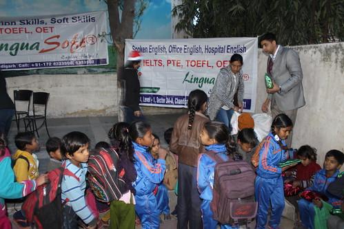 Gift distribution to children by Directors of LinguaSoft EduTech Chandigarh at Ashiana children's home