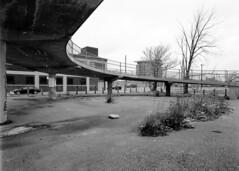 kodaktmax100120-060 (elsuperbob) Tags: newtopographics detroit michigan corktown motorcitycasino urban winter concrete mamiyam645 kodak tmax100 kodaktmax100 empty