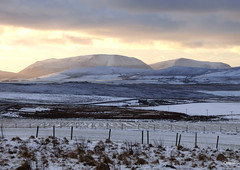 Snowy Hills In The Orkney Islands (orquil) Tags: snowy hills orkney islands winter snow january elevated westerly view twartquoy greenigoe viewpoint nearby buildings houses hobbister farmland farm orphir parish rural scattered whitefields farms uncultivated orphirhills westmainland distant background hoyhills silhouette wardhill highest cuilags secondhighest hill afternoon low sun bright sky dominating clouds cloudscape scotland uk unitedkingdom greatbritain orcades wintery memorable scenic seasonal interesting nice