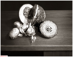 Onion and squash (DelioTO) Tags: 4x5 aph09 autaut blackwhite canada closeup f307 fomapan100 march ontario pinhole stilllife winter