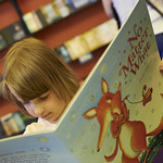 Enjoying a book in the Baillie Gifford Children's Bookshop
