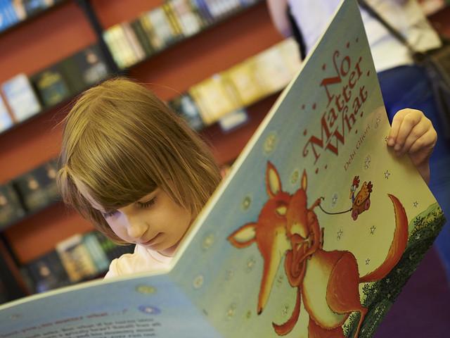 Enjoying a book in the Baillie Gifford Children's Bookshop