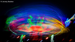 Fair Enough (JKmedia) Tags: abstract blur night speed lights neon colours bright fairground plymouth fair flags trail entertainment icecream hoe colourful thrill 15challengeswinner canoneos5dmkiii boultonphotography