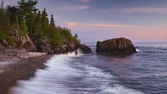 lake superior lll (twurdemann) Tags: trees sunset summer sky seascape ontario canada blur nature water clouds landscape evening rocks surf waves shoreline scenic transcanadahighway lakesuperior highway17 northernontario algoma latesummer stonebeach nikcolorefex 16x9crop viveza sawpitbay procontrast xf1855mm fujixt1