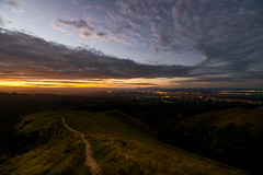 The long trek home (ajecaldwell11) Tags: light sunset newzealand sky grass clouds lights track dusk path hastings hawkesbay tematapeak havelocknorth goldenlight