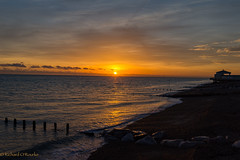 beautiful sunset (Rourkeor) Tags: worthing unitedkingdom england uk orange sunset seaside reflections silhouette rocks water waves horizon shore beach sony sonyrx1r rx1r fullframe carlzeiss zeiss sonnar t 35mm