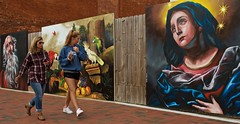 Checking out the artwork (tvdflickr) Tags: georgia marietta usa mariettasquare mural paintings pedestrians colorful girl woman women females bricks boards signs fence copyright photobytomdriggers thomasdriggersphotography photosbytomdriggers